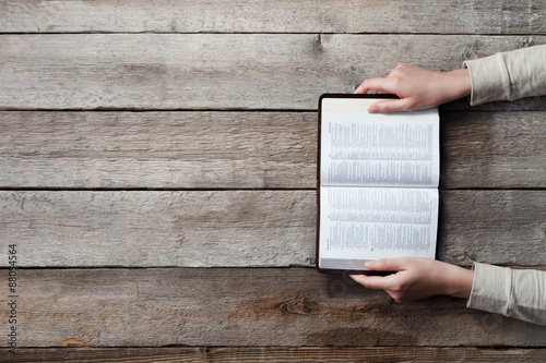 Fototapeta woman hands on bible