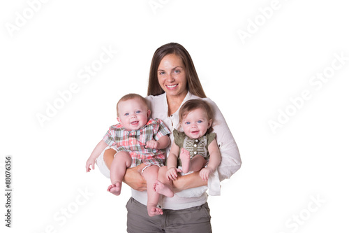 Fotografia, Obraz  A mother and her fraternal boy/girl twins isolated
