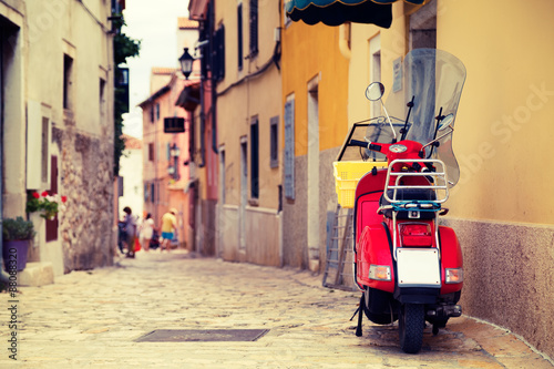 Tuinposter Scooter Scooter on the Street of Mediterranean Town