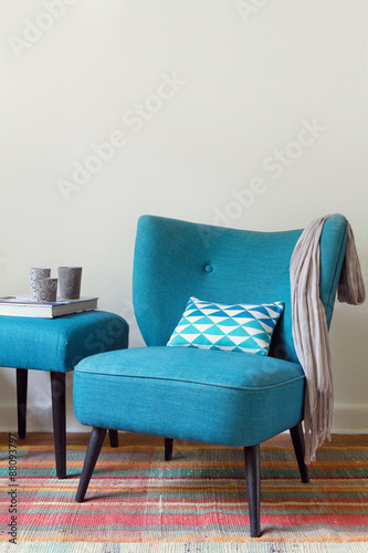 Fototapety, obrazy: Teal blue retro armchair and ottoman with decor objects home interior vertical
