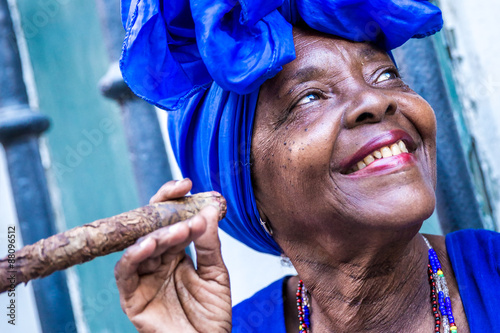 Fotobehang Havana Portrait of african cuban woman smoking cigar in Havana, Cuba