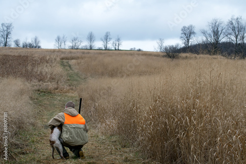 Spoed Foto op Canvas Jacht Young Man and Bird Dog Hunting Companion