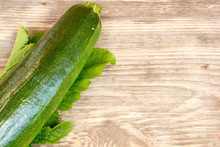 Zucchinis On Wood Background With Copy Space