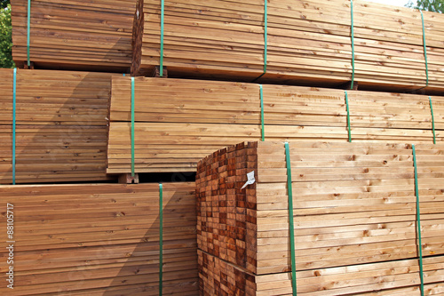 Obraz stack of wooden terrace planks at the lumber yard - fototapety do salonu