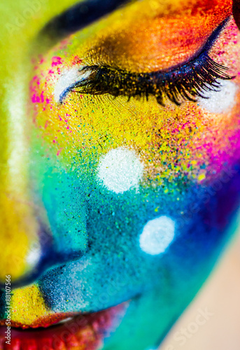 Close up portrait of beautiful fashion woman with color art