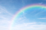 Fototapeta Rainbow - rainbow in the clear blue sky after the rain, the rainy season.