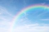 Fototapeta Tęcza - rainbow in the clear blue sky after the rain, the rainy season.