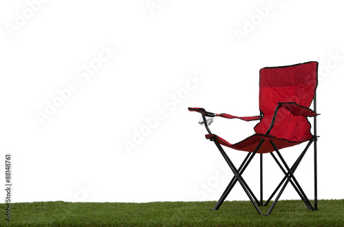 Fotografie, Obraz  Folding camp chair on grass with white background