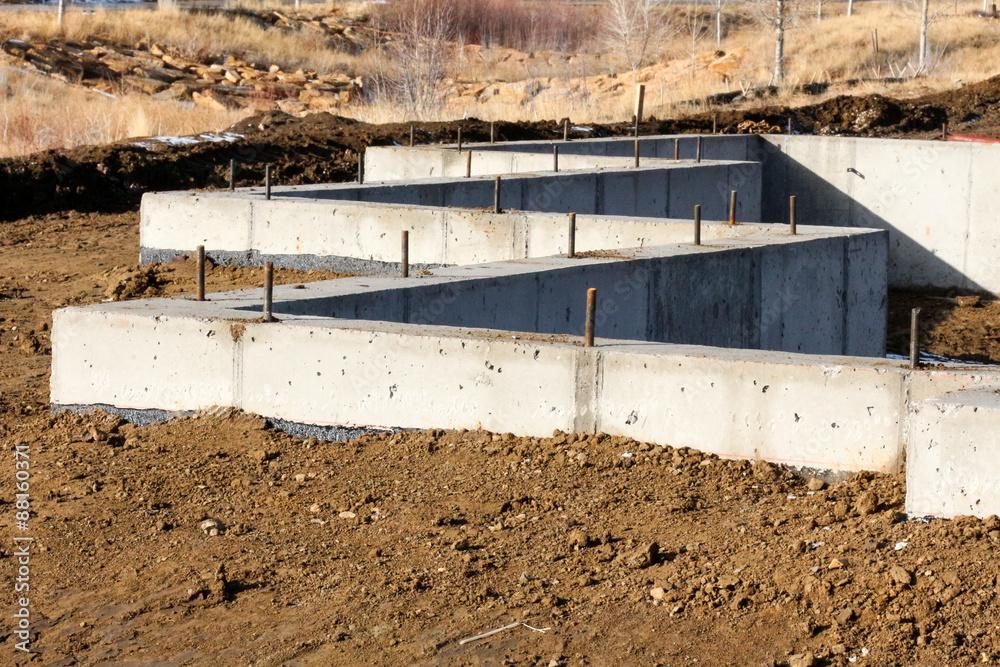 Fototapeta Zig zag concrete foundation on a home being built