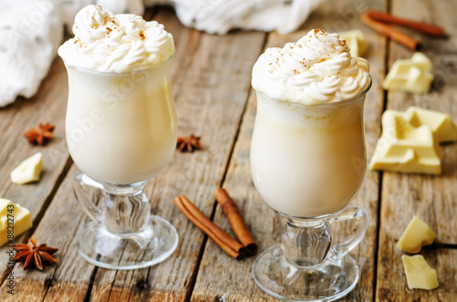 Foto op Canvas Chocolade hot white chocolate decorated with whipped cream with cinnamon