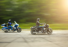 Two Bikers Riding Unknown Motorbike With Blur Movement, Speed Co