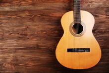 Acoustic Guitar On Wooden Back...