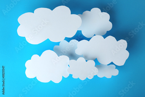 Foto op Plexiglas Hemel White paper clouds on blue background. Cloud computing concept.
