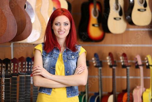 Spoed Foto op Canvas Muziekwinkel Beautiful young woman in music store