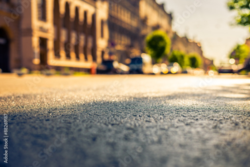 plakat City on a sunny day, a quiet street after rain with trees and cars