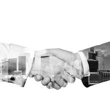 A Stylish White Black Handshake With New York Cityscape. Isolated On White.