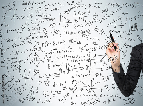 Woman's hand is pointing out the complicated math calculations. Math formulas are written on the glass screen.