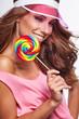 Bright makeup. Beauty Girl Portrait holding Colorful lollipop. P