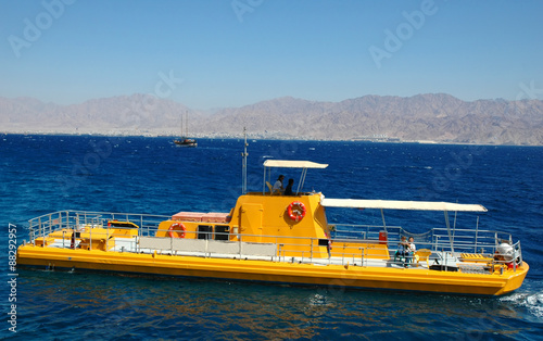 Yellow submarine on the background of the Red Sea and Mount Hor, Eilat Israel Canvas Print