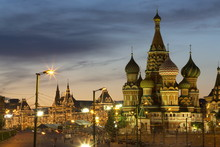 Gum Department Store And The Onion Domes Of St. Basil's Cathedral In Red Square Illuminated At Night, Moscow, Russia