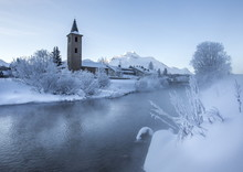 The Church Of Sils-Baselgia, In A Winter Landscape Covered In Snow In Lower Engadine, From The Banks Of River Inn After Sunrise, Graubunden