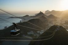 View From The Sugarloaf And The Famous Cable Car At Sunset, Rio De Janeiro, Brazil