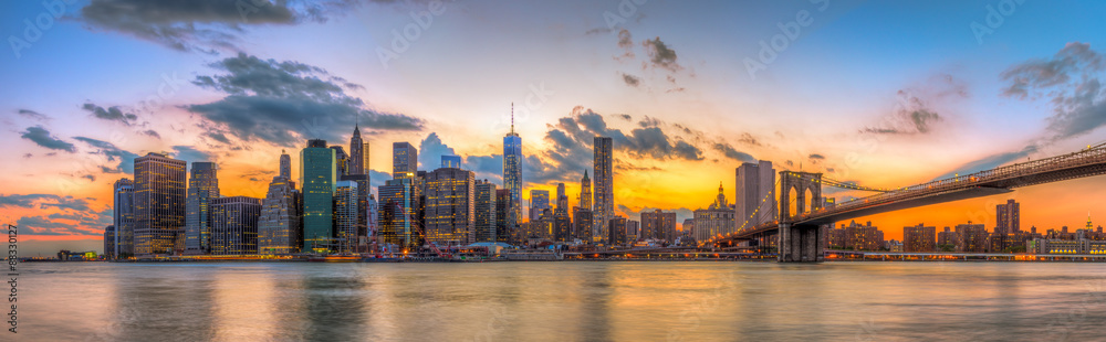 Brooklyn bridge and downtown New York City in beautiful sunset