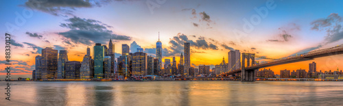 Photo Stands New York City Brooklyn bridge and downtown New York City in beautiful sunset
