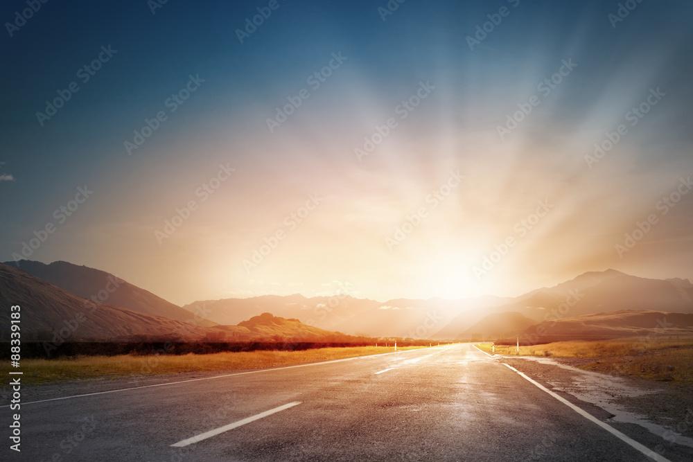 Fototapeta Sunrise above road