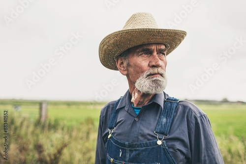 Fotomural Pensive Farmer at the Farm Looking into Distance
