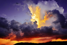 Dramatic Dark Purple And Red Storm Clouds At Sunset