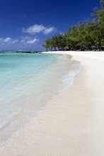 Idyllic Beach Scene With Blue Sky, Aquamarine Sea And Soft Sand, Ile Aux Cerfs, Mauritius