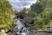 The Thomas Telford Bridge And The Invermoriston Falls And River On The Shores Of Loch Ness, Scotland
