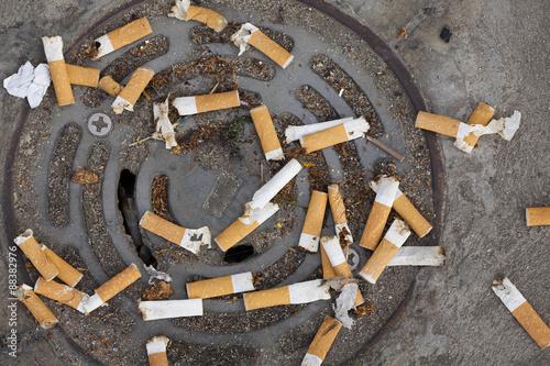 Fotografija  Cigarette butts littering