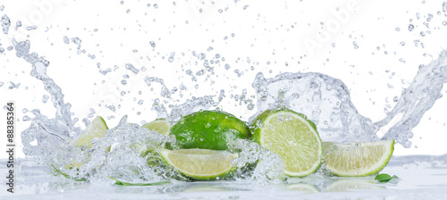 Fresh limes with water splashes - 88385364