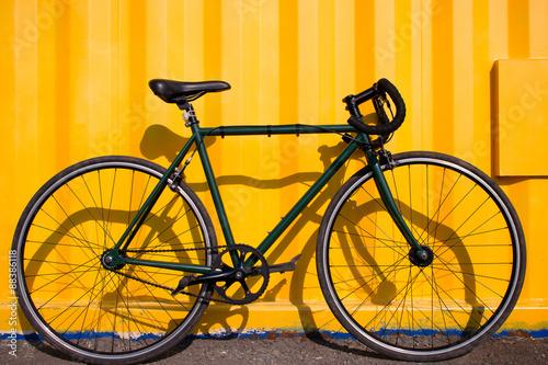 Fotobehang Fiets city bike fixed gear on a yellow background