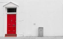Red Wooden Door With Silver Mail Door Slot And Door Knocker