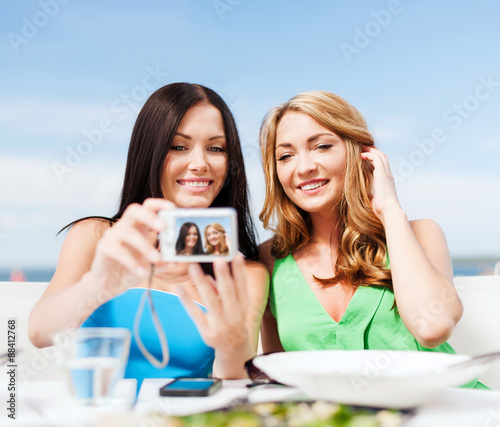 Girls Taking Photo In Cafe On The Beach Buy This Stock