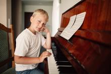Boy Plays Piano At Home