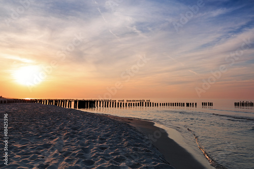 Sunset and breakwaters on the Baltic Sea. Long exposure