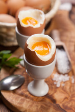 Boiled Eggs On A Wooden Backgr...