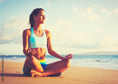 Spoed Foto op Canvas School de yoga Woman Practicing Yoga on the Beach at Sunset