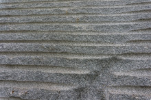 Close Up Of Grey Granite Block Showing The Pattern Of Grooves That Industrial Diamond Drills Made
