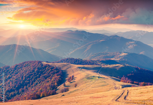 Foto auf Gartenposter Hugel Colorful autumn sunrise in the Carpathian mountains