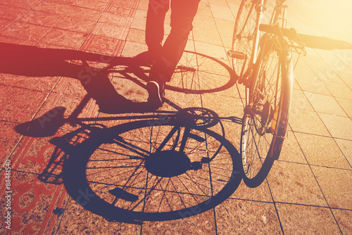 Spoed Foto op Canvas Fiets Shadow on Pavement, Man Pushing Bicycle