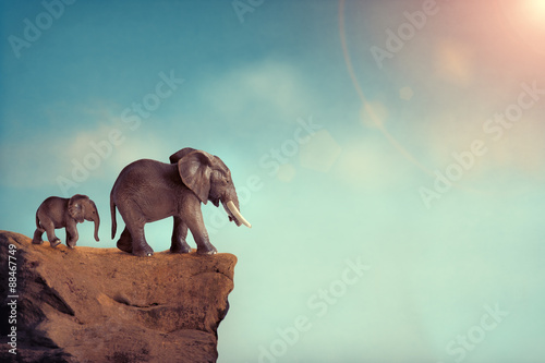 extinction-concept-elephant-family-on-edge-of-cliff