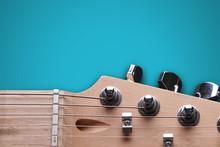 Head Of Electric Guitar On Blu...