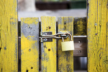 Yellow Wooden Fence With Lock