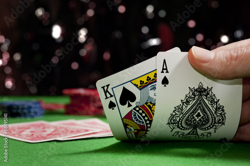 Photo  Playing cards in a game of poker