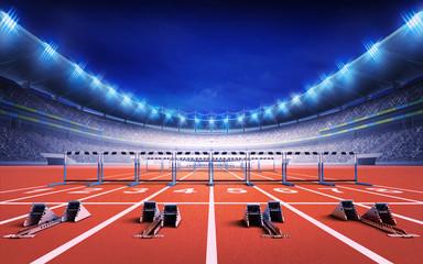 Fototapeta athletics stadium with race track with starting blocks and hurdles